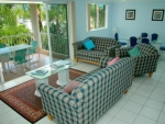 Surfers Beach Holiday Apartments, Lounge And Dining With Balcony Overlooking Pool