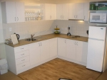 Well equiped kitchen with all utensils, full size fridge, microwave & outdoor BBQ