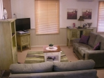 Large loungeroom with log fire, flat scrren TV, DVD's provided, iPOD player,