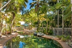 Tropical Nites holiday apartments free form salt water swimming pool.