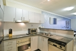 Fully equipped kitchen with dishwasher, full sized fridge and Blanco oven and bench hot plates